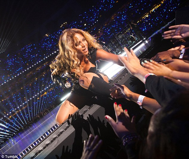 Her adoring fans: Beyonce shared a snap on her Tumblr of herself reaching out to fans