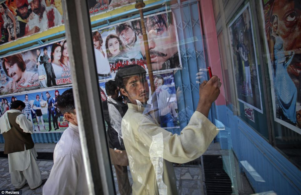 This Reuters picture of an Afghan cinema goer attempts to capture change in Kabul