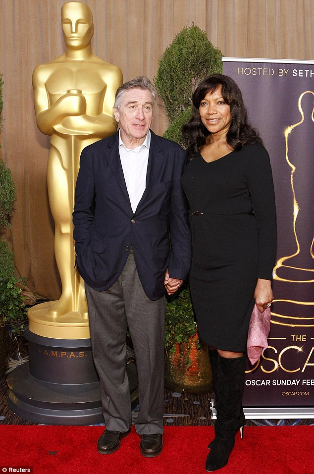 Mad rush: Robert and wife Grace dashed across town after the hand and footprint ceremony for the 85th Academy Awards nominees luncheon in Beverly Hills on Monday