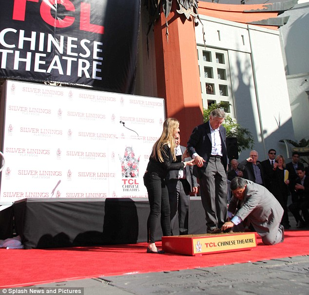 Making history: Robert is on of the many entertainment legends to have had their hand and footprints immortalised in concrete outside the theatre with current stones seen in the foreground