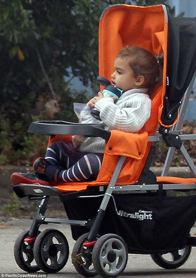 Content: Her daughter Vida sat happily in her pram sipping on a water bottle as she took in the sights and sounds of the zoo