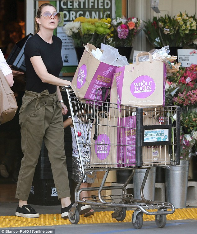 Keeping it casual: Ellen dressed down for her day of chores in a pair of khaki cargo pants and a simple black T-shirt, while scraping her brunette locks back off her face into a ponytail