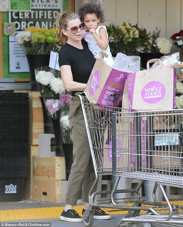 Keeping her sweet: Ellen Pompeo treated her adorable daughter Stella to a tasty lollipop as they stocked up on groceries at Whole Foods market on Sunday