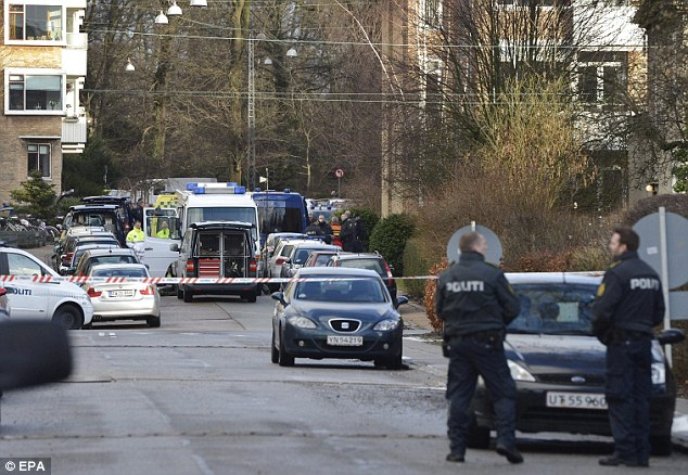 Investigation: Danish police outside Mr Hedegaard's apartment in Frederiksberg, where a gunman fired a shot that narrowly missed the writer's head