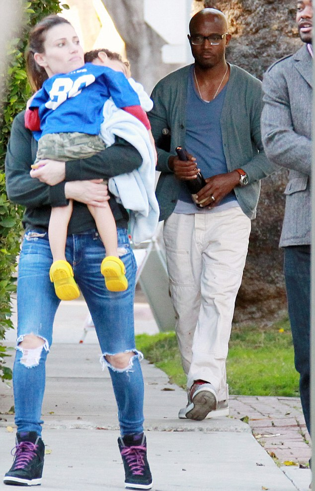 Sunday fun day: A week after tackling an alleged home invader, Taye Diggs enjoyed a more relaxing Sunday with his family and friends in Los Angeles, California