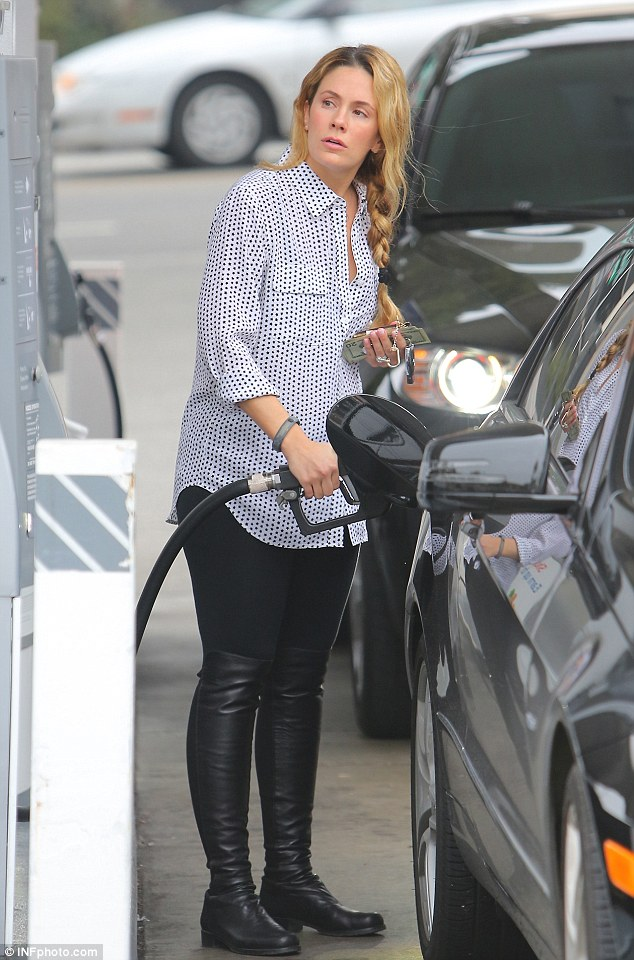 Baby on board: Pregnant Cacee Cobb fills her car with gas before heading to lunch with a friend in Los Angeles on Tuesday