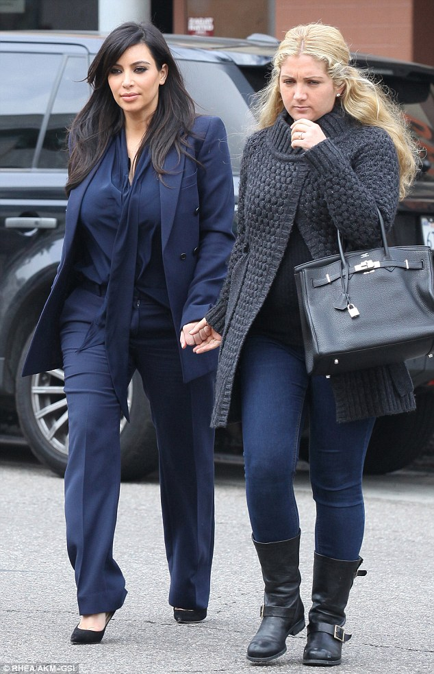 Shopping trip: Pregnant Kim Kardashian and a friend went shopping in swanky Robertson Boulevard after the reality star met with her lawyer Laura Wasser earlier in the day on Tuesday