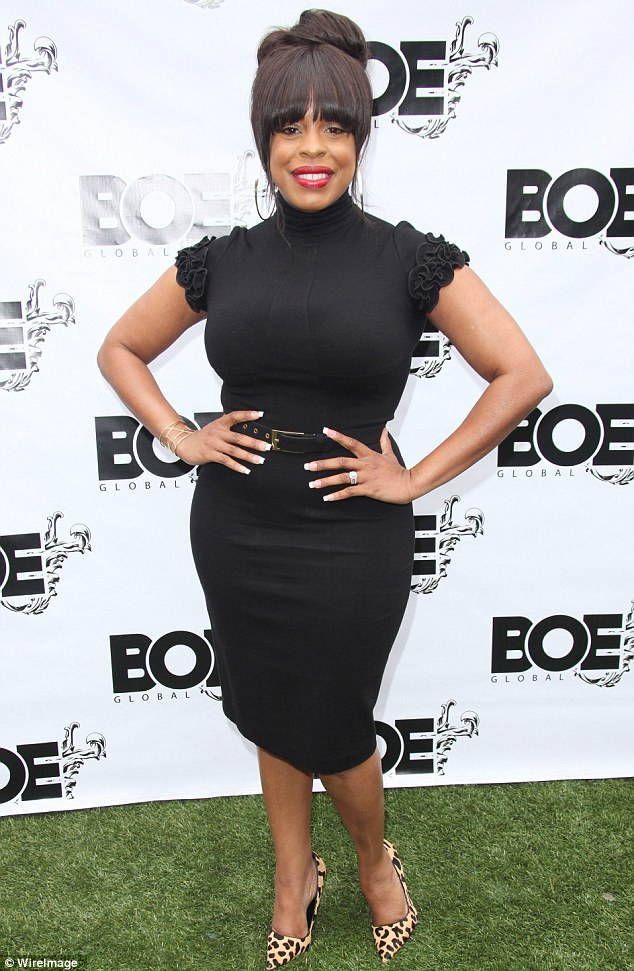 Lady in black: Reno 911! star Niecy Nash slipped into a little black dress for the event