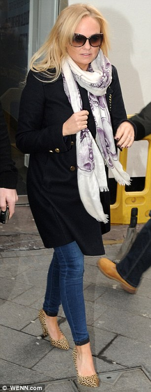 Sad times: Emma put on a brave face as she left the Heart FM studios on Wednesday morning