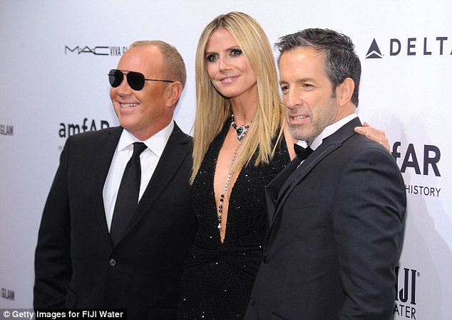 Dapper: Michael Kors, Heidi Klum and Kenneth Cole pose up, Heidi's poker straight her perfectly complimented her sleek look