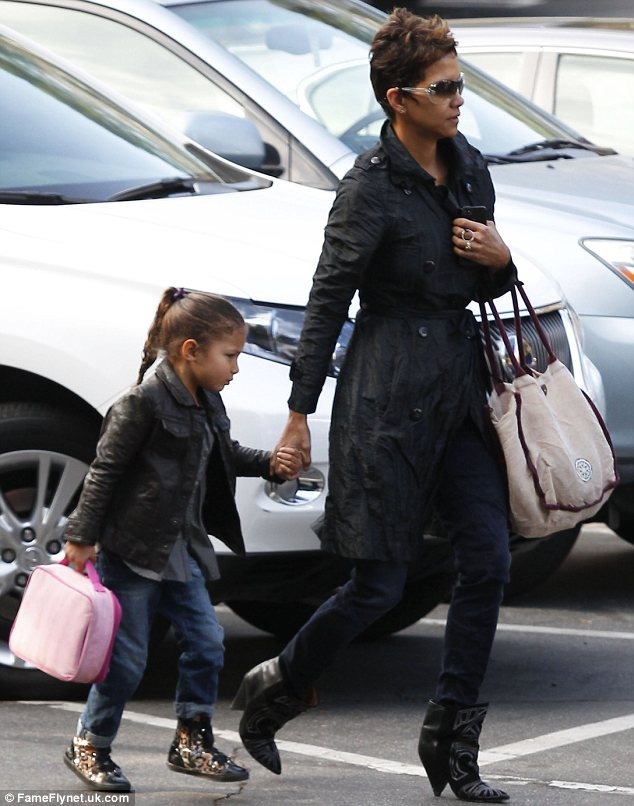Off we go: Halle held on tight to Nahla's hand as they made their way to school in Los Angeles on Wednesday