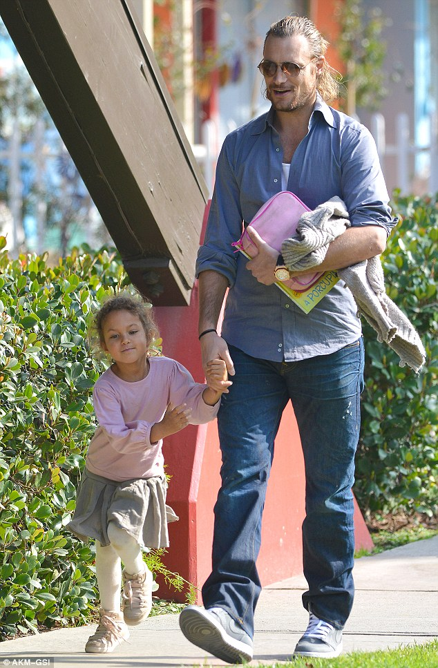 How adorable! Nahla and Gabriel can't help but laugh as they stroll down the street