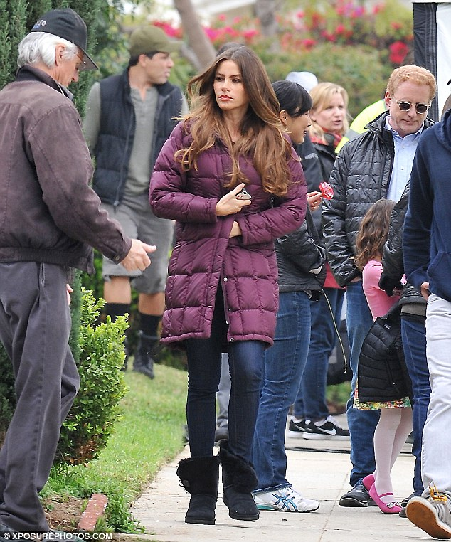 Warming up: Sofia Vergara took the chill out of the afternoon on Thursday in this purple padded jacket on set of Modern Family