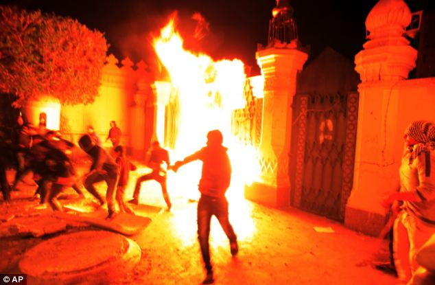Throwing projectiles: Egyptian protesters throw fire bombs and stones at the presidential palace during a demonstration in Cairo