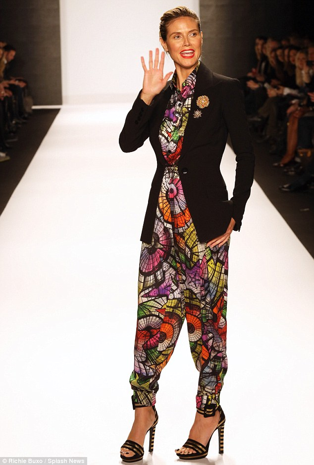 Standing out: Heidi's jacket was paired with a garish printed all-in-one and a pair of sky-high black and gold heels