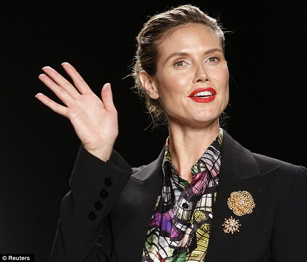 Red alert: The German supermodel wore her blonde locks slicked back and had lashings of bright red lipstick on her lips