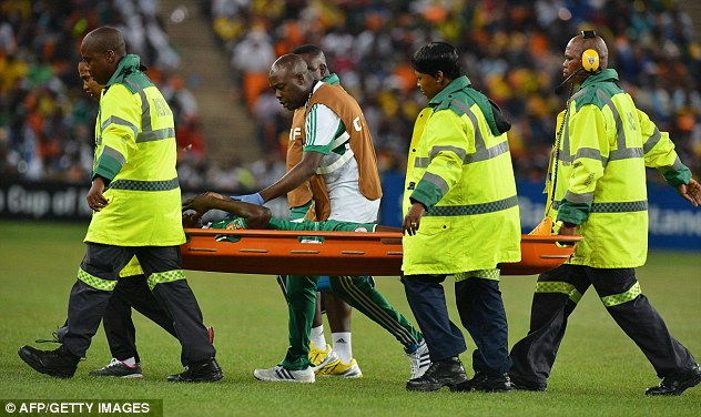 Concern: Nigeria defender Elderson Echiejile leaves the pitch on a stretcher after sustaining an injury