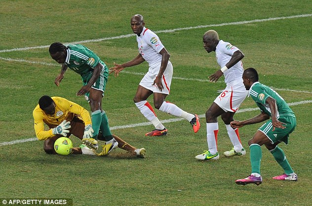 Holding on: Burkina Faso keeper Diakite saves from Moses