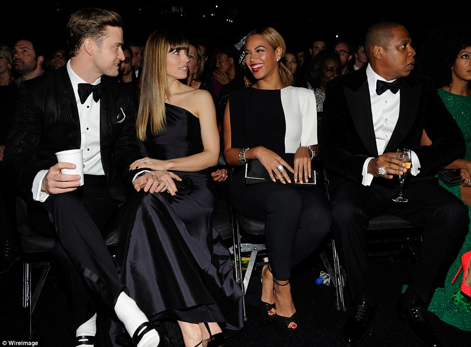 Power couple pow-wow: The famous foursome were in a celebratory mood and dressed to the nines