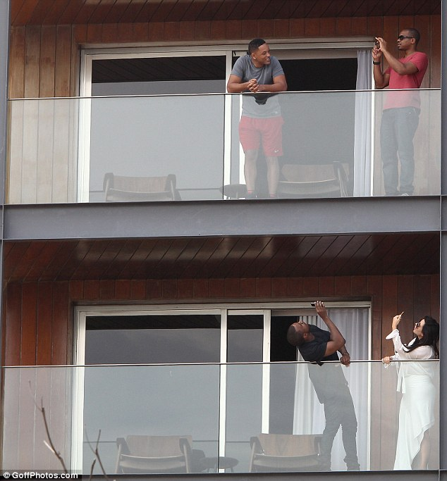 Kanye turns pap: The rapper snaps a photo of his upstairs neighbour