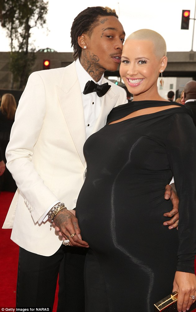 Proud parents-to-be: Grammy nominated Whiz whispers sweetly in his pregnant fiancee's ear