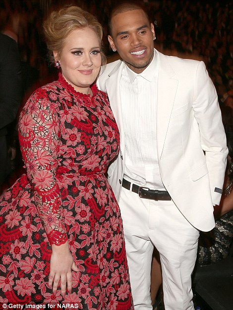 Mingling: Adele enjoyed catching up with Chris Brown and Frank Ocean