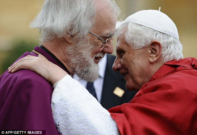 Warm welcome: The Archbishop of Canterbury, Rowan Williams, greets Pope Benedict XVI at Lambeth Palace in central London on September 17, 2010