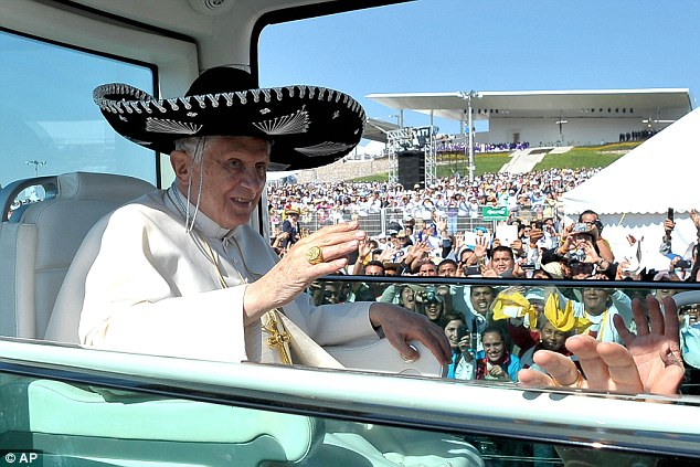 Sense of fun: Pope Benedict XVI waves from the Popemobile wearing a Mexican sombrero as he arrives to give a Mass in Bicentennial Park near Silao, Mexico, on March 25, 2012
