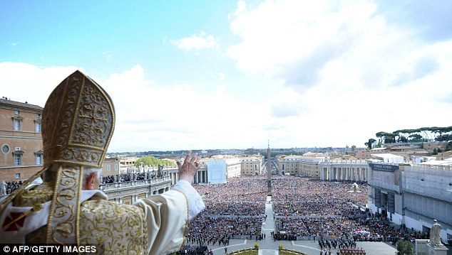 Throngs: Pope Benedict XVI delivering the 'Urbi et Orbi' Message and blessing to faithful from the central loggia of St Peter's basilica after the Easter Holy Mass at The Vatican in April 2012