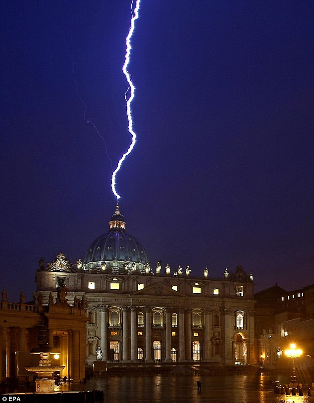 A sign from God? Lighting strikes the basilica of St.Peter's dome earlier this evening during a storm that struck Rome on the same day Pope Benedict XVI announced his resignation