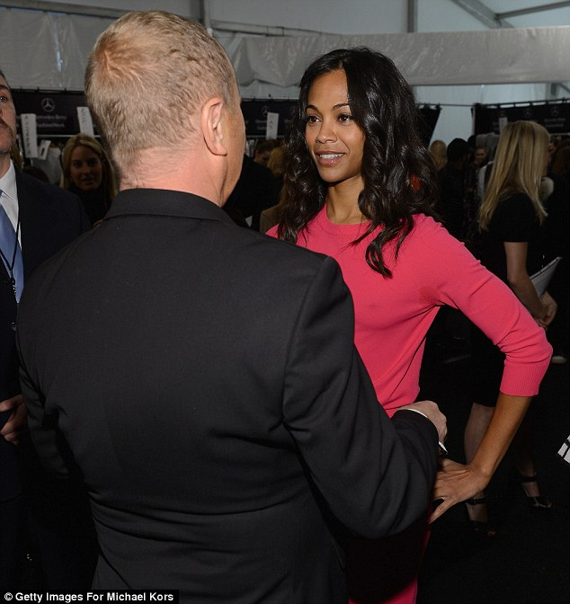 Pleased to see you: Designer Kors gives actress Zoe a hug backstage