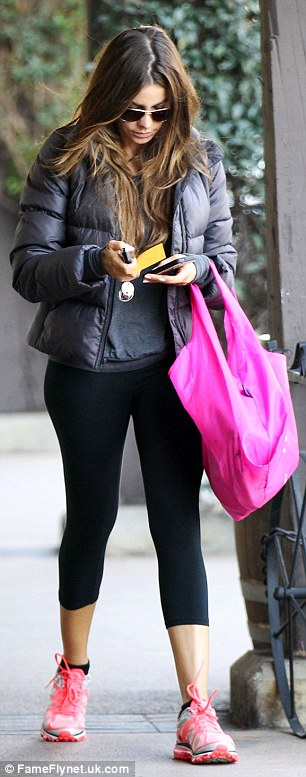 Hands full: The busy actress opted not use her bag, rather choosing to carry her phone, keys and other items in her hands