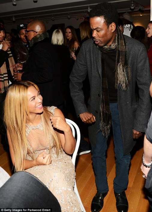 Another admirer: Beyonce laughed as she was approached by comedian Chris Rock