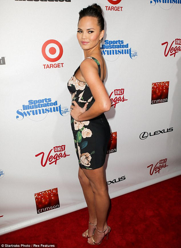 Dress to impress: Chrissy wowed in a form-fitting floral dress as she attended the Sports Illustrated 2013 Swimsuit Edition celebration in New York on Tuesday night