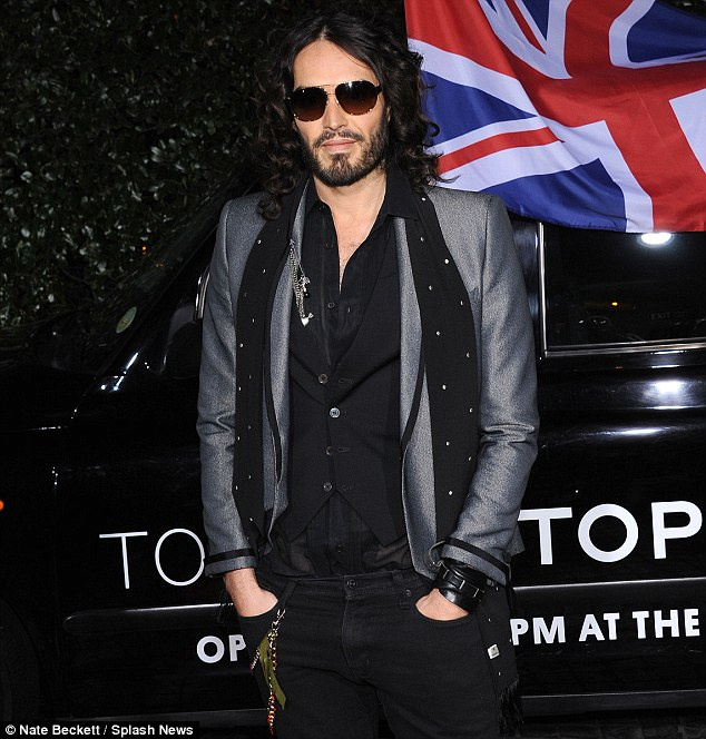 Doing it for the boys: Russell Brand looked dapper in a grey jacket, black scarf and dark shades as he toasted the launch of the British brand in Hollywood
