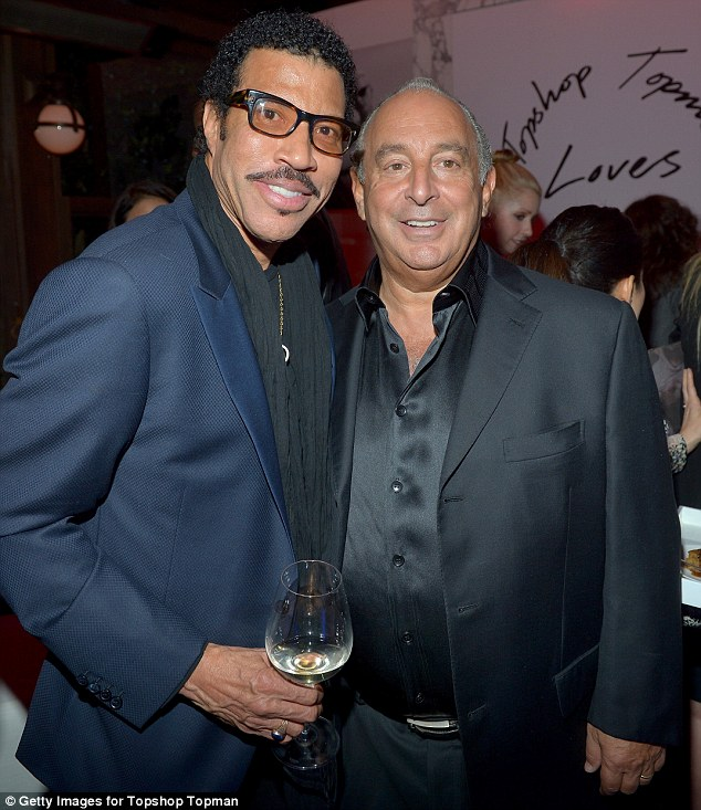 Making friends: Lionel Richie enjoyed a glass of wine with the fashion mogul as they celebrated the Topshop launch together