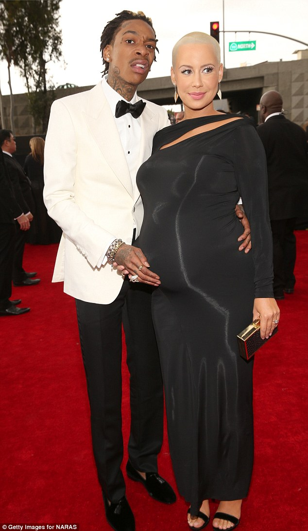 Buzz cut: Amber showed off her platinum barely-there hair while attending the Grammys on Sunday with fiance Wiz Khalifa