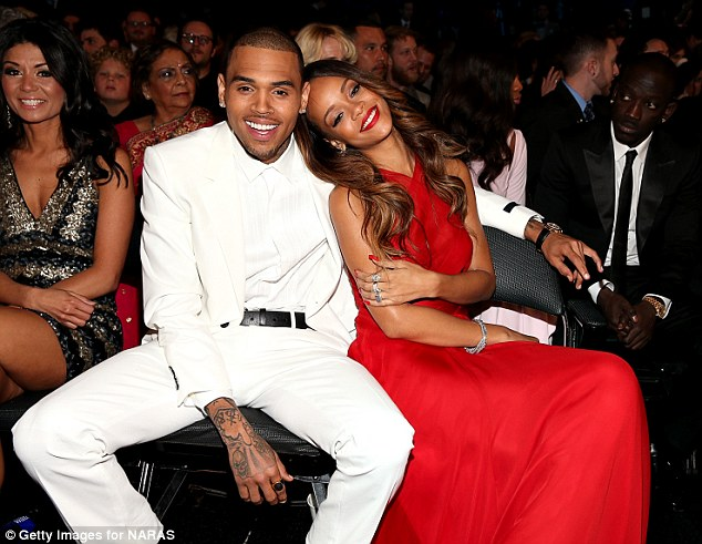 Happy days: The couple were snapped looking loved-up as they sat in the front row at the Grammy Awards on Sunday