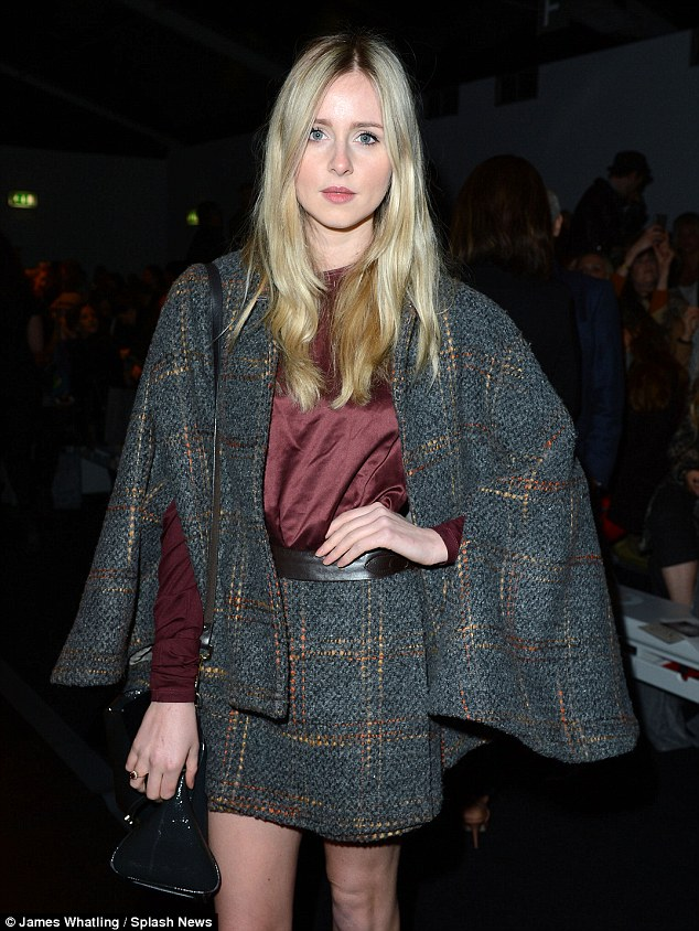 Singer to style icon: The former X Factor star turns heads in the designer's outfit, pairing the tweed suit with a maroon top
