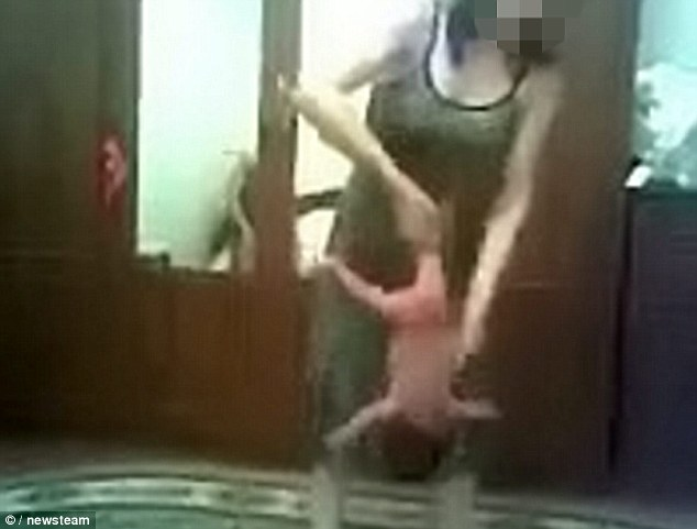 Horrifying: Swung around like a toy, a tiny baby boy is flipped, twisted and spun around in shocking footage of 'child yoga'