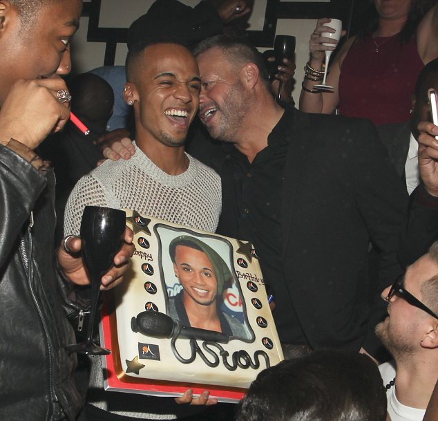Happy times: Sugar Hut owner Mick Norcross presented Aston with his birthday cake
