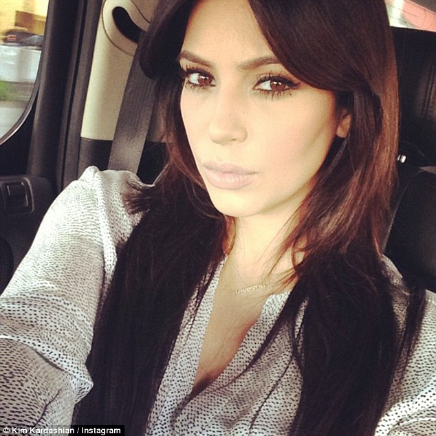 Oops! Pregnant Kim Kardashian opted against safely securing her growing baby bump with a seatbelt while snapping an Instagram 'selfie' in the car on the way to LAX Friday afternoon