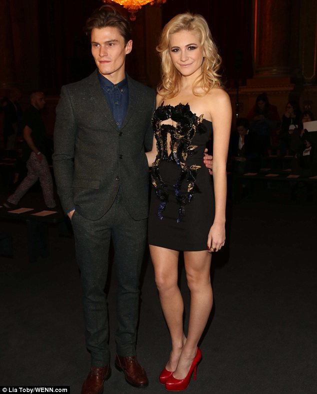 Cute couple: Pixie Lott arrived with her boyfriend Oliver Cheshire at the fashion show