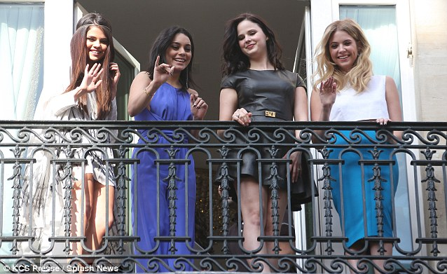 Hello fans: The Spring Breakers stars came out on to the balcony of their Paris hotel to wave to their loyal followers who had gathered below