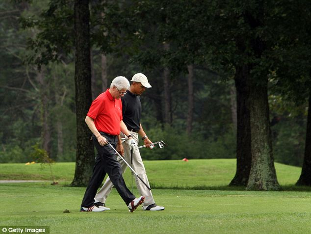 Hitting the links: President Obama, seen here playing with former President Clinton in 2011, has played more than 100 rounds of golf during his presidency