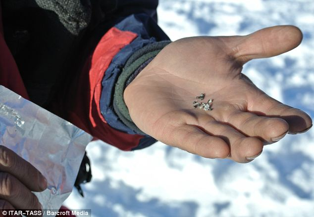 Space rock: A man holding a meteorite fragment found near the Chebarkul Lake.