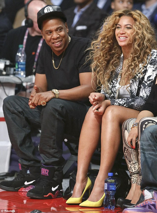 Game on: Beyonce and Jay-Z sit court-side at the NBA All-Star game in Houston, Texas on Sunday