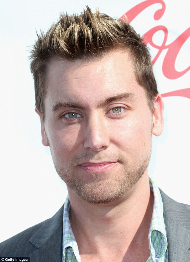 Pop your collar: Lance Bass wore an open collared shirt and a grey suit