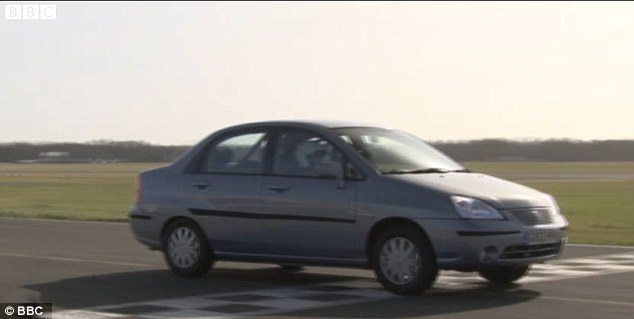 Showing them how it's done: The Formula One ace managed to lap the circuit in a Suzuki Liana in an impressive time of 1 minute and 42 seconds