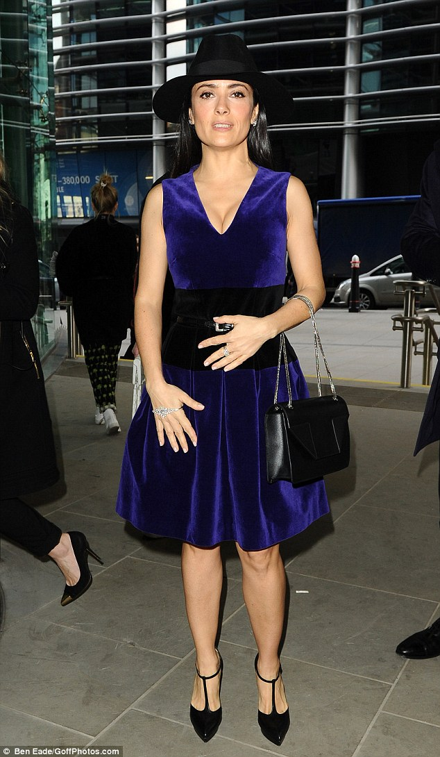Divine in velvet: Salma Hayek was lovely in her purple frock as she attended the Christopher Kane show during London Fashion Week on Monday